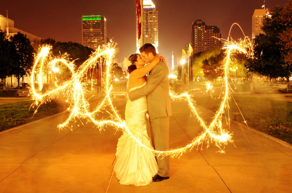 Sparklers In Front Of Kissing Couple