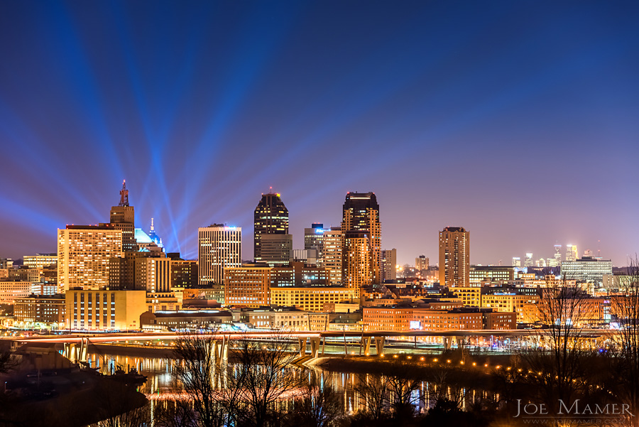 Saint Paul Minnesota skyline from Mounds Park with  blue searchlights.